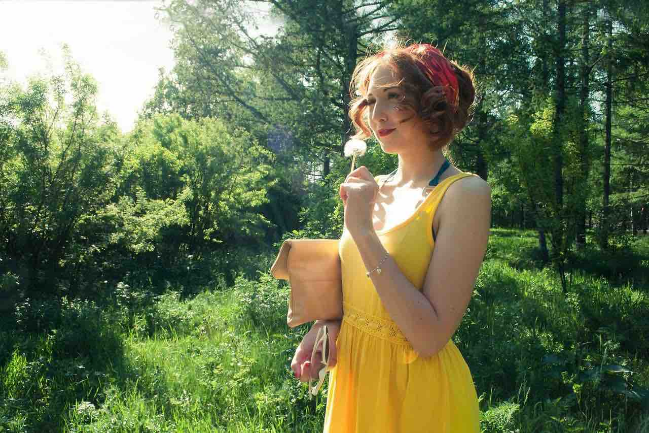 girl with dandelion yellow dress